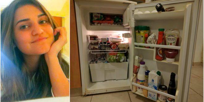 אלונה רגב לצד המקרר שלה. צילום: גלעד ילון